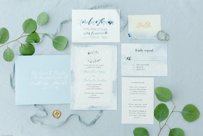 Dusty Blue Wedding Invitation Flatlay: Fresh Garden Party Wedding Inspiration from Jackson Signature Photography & Joy Filled Occasions featured on Burgh Brides