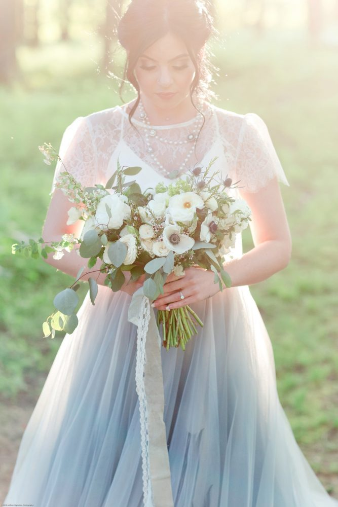 Bride in Dusty Blue Wedding Dress with Bouquet of White Flower and Greenery: Fresh Garden Party Wedding Inspiration from Jackson Signature Photography & Joy Filled Occasions featured on Burgh Brides