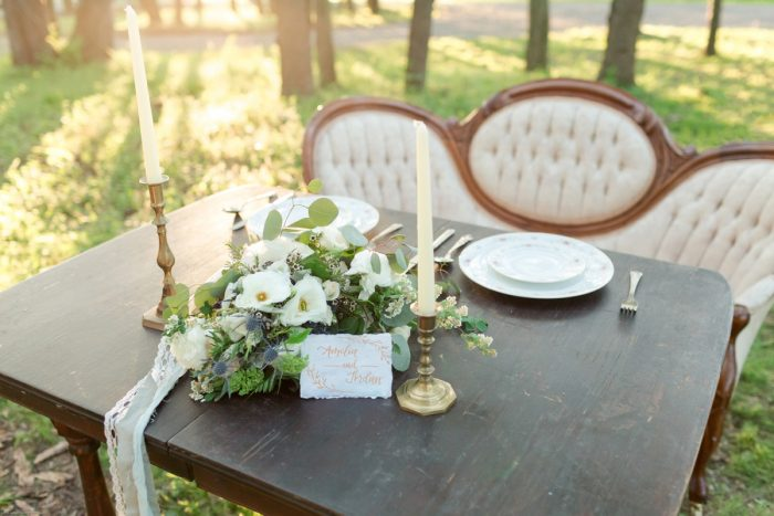 Wooden Table with Vintage Decor and Antique Settee at Wedding: Fresh Garden Party Wedding Inspiration from Jackson Signature Photography & Joy Filled Occasions featured on Burgh Brides