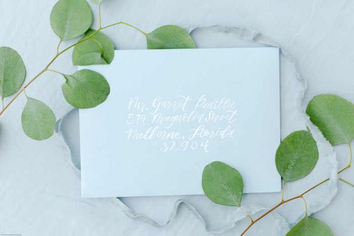 Dusty Blue Envelopes with White Calligraphy: Fresh Garden Party Wedding Inspiration from Jackson Signature Photography & Joy Filled Occasions featured on Burgh Brides