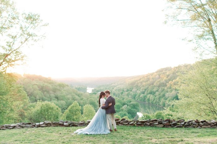 Bride in Dusty Blue Wedding Dress with Groom in Woods: Fresh Garden Party Wedding Inspiration from Jackson Signature Photography & Joy Filled Occasions featured on Burgh Brides