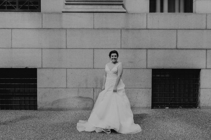 Bride Dancing in Streets: Hip Pink & Blue Rooftop Wedding at Hotel Monaco from Rachel Rowland Photography featured on Burgh Brides