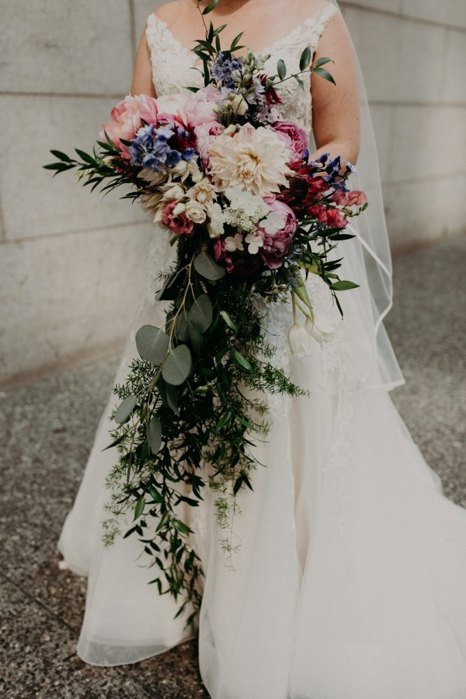 Cascading Bridal Bouquet with Pink, White, and Purple Flowers: Hip Pink & Blue Rooftop Wedding at Hotel Monaco from Rachel Rowland Photography featured on Burgh Brides