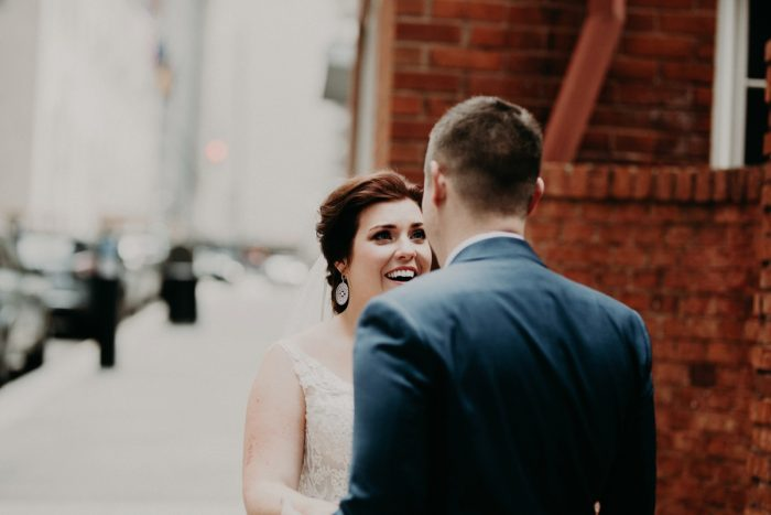 Bride and Groom First Look: Hip Pink & Blue Rooftop Wedding at Hotel Monaco from Rachel Rowland Photography featured on Burgh Brides