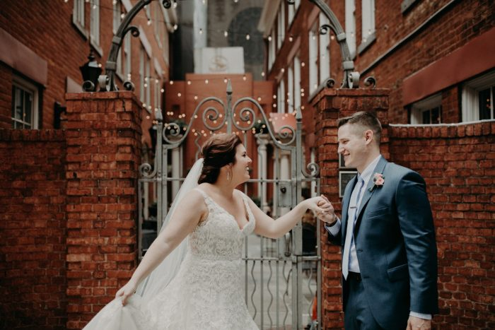 Bride and Groom First Look Downtown Pittsburgh: Hip Pink & Blue Rooftop Wedding at Hotel Monaco from Rachel Rowland Photography featured on Burgh Brides