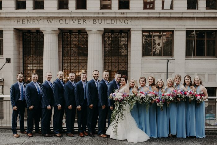 Bridesmaids in Light Blue Dresses and Groomsmen in Navy Suits: Hip Pink & Blue Rooftop Wedding at Hotel Monaco from Rachel Rowland Photography featured on Burgh Brides
