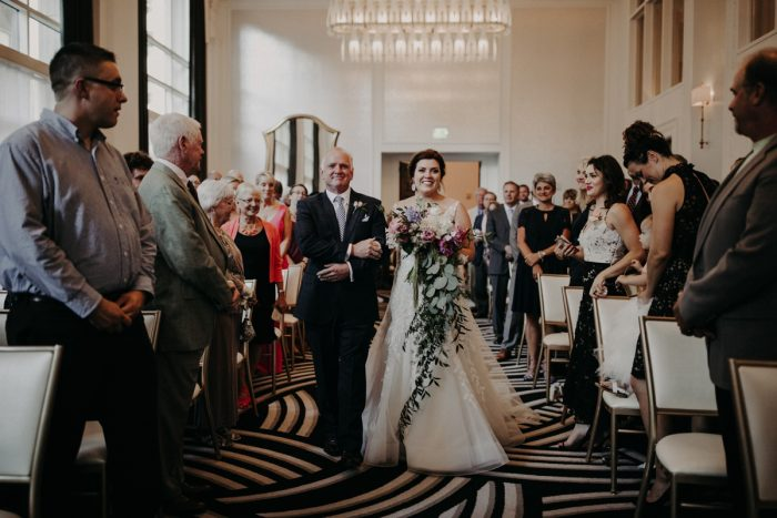 Bride Walking Down Aisle with Father: Hip Pink & Blue Rooftop Wedding at Hotel Monaco from Rachel Rowland Photography featured on Burgh Brides