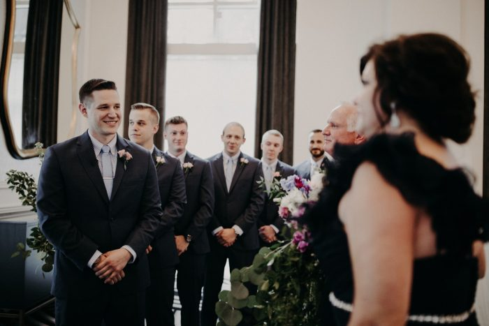 Groom Smiling at Bride Wedding Ceremony: Hip Pink & Blue Rooftop Wedding at Hotel Monaco from Rachel Rowland Photography featured on Burgh Brides