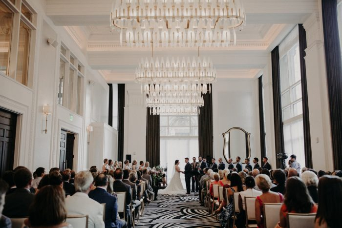 Wedding Ceremony at Hotel Monaco: Hip Pink & Blue Rooftop Wedding at Hotel Monaco from Rachel Rowland Photography featured on Burgh Brides