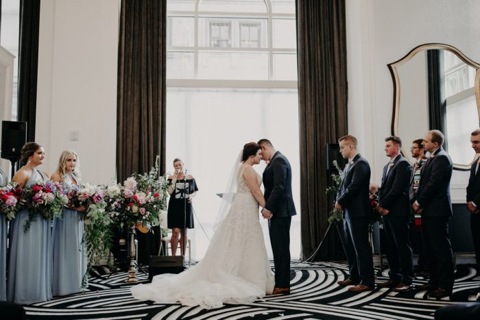 Bride and Groom During Wedding Ceremony: Hip Pink & Blue Rooftop Wedding at Hotel Monaco from Rachel Rowland Photography featured on Burgh Brides