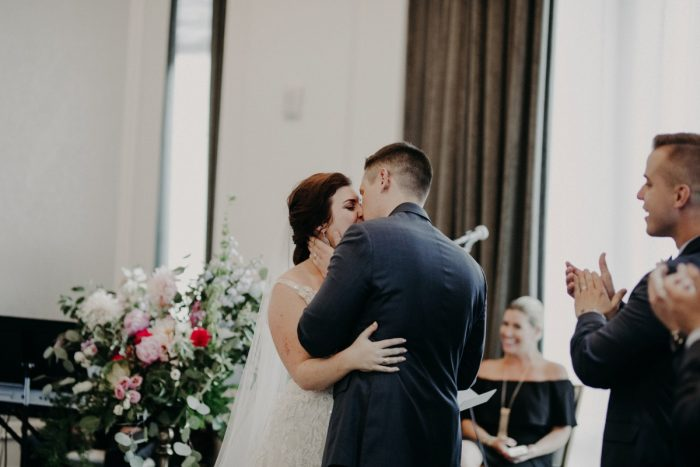 Bride and Groom First Kiss: Hip Pink & Blue Rooftop Wedding at Hotel Monaco from Rachel Rowland Photography featured on Burgh Brides