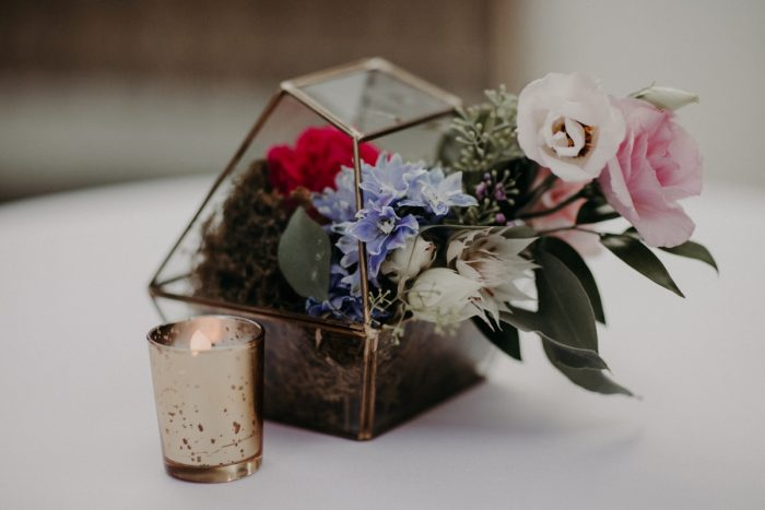 Gold Glass Terrarium with Blue, Red, and White Flowers: Hip Pink & Blue Rooftop Wedding at Hotel Monaco from Rachel Rowland Photography featured on Burgh Brides