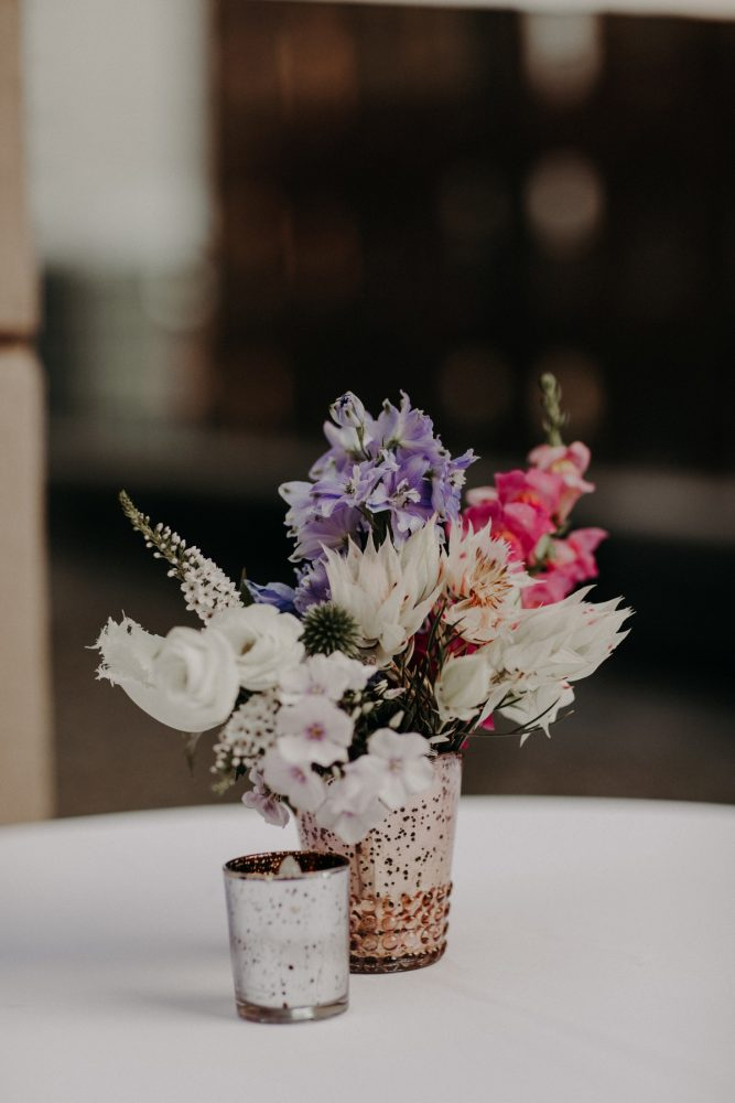 Cocktail Table Centerpiece Blue, White, and Pink Flowers in Gold Mercury Glass: Hip Pink & Blue Rooftop Wedding at Hotel Monaco from Rachel Rowland Photography featured on Burgh Brides