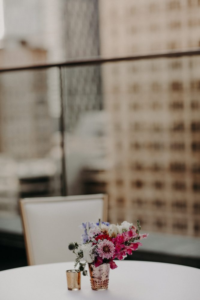 Pink and Blue Wedding Centerpiece Gold Vase: Hip Pink & Blue Rooftop Wedding at Hotel Monaco from Rachel Rowland Photography featured on Burgh Brides