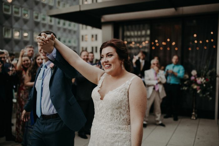 Bride and Groom Entering Reception: Hip Pink & Blue Rooftop Wedding at Hotel Monaco from Rachel Rowland Photography featured on Burgh Brides