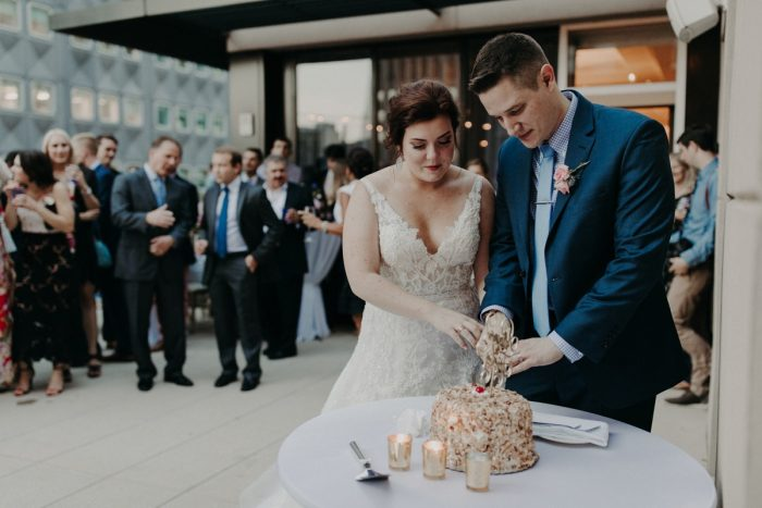 Bride and Groom Cutting Cake: Hip Pink & Blue Rooftop Wedding at Hotel Monaco from Rachel Rowland Photography featured on Burgh Brides
