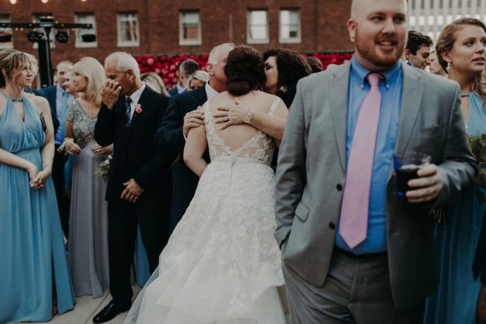 Bride Hugging Parents: Hip Pink & Blue Rooftop Wedding at Hotel Monaco from Rachel Rowland Photography featured on Burgh Brides