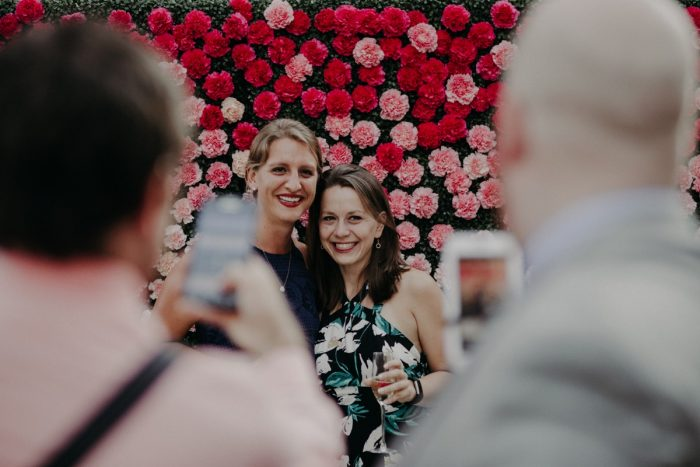 Guests Smiling at Reception: Hip Pink & Blue Rooftop Wedding at Hotel Monaco from Rachel Rowland Photography featured on Burgh Brides
