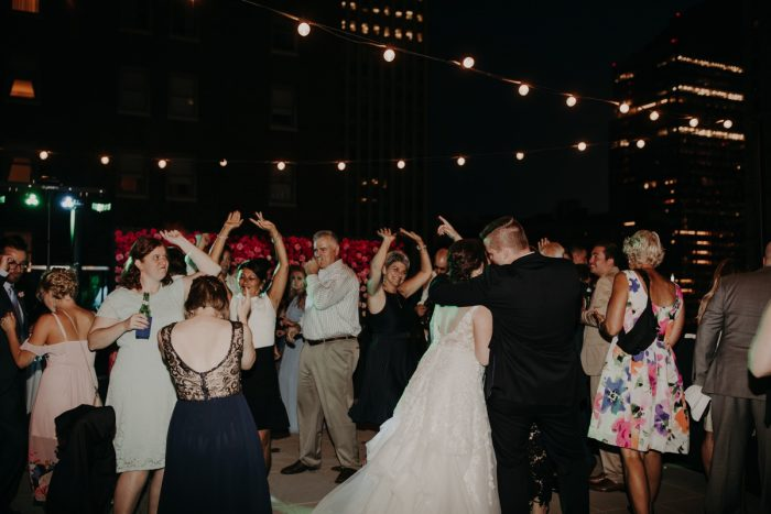 Guests on Wedding Dance Floor: Hip Pink & Blue Rooftop Wedding at Hotel Monaco from Rachel Rowland Photography featured on Burgh Brides