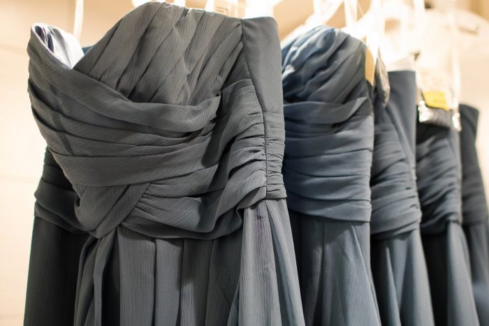Dusty Blue Bridesmaids Dresses on Hanger: Lush Blue & Burgundy Wedding at the Heinz History Center from Christina Montemurro Photography featured on Burgh Brides