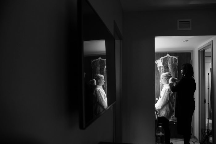 Bride Getting Ready in Mirror: Lush Blue & Burgundy Wedding at the Heinz History Center from Christina Montemurro Photography featured on Burgh Brides