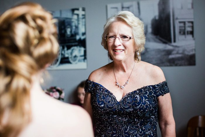 Mom Smiling at Bride: Lush Blue & Burgundy Wedding at the Heinz History Center from Christina Montemurro Photography featured on Burgh Brides