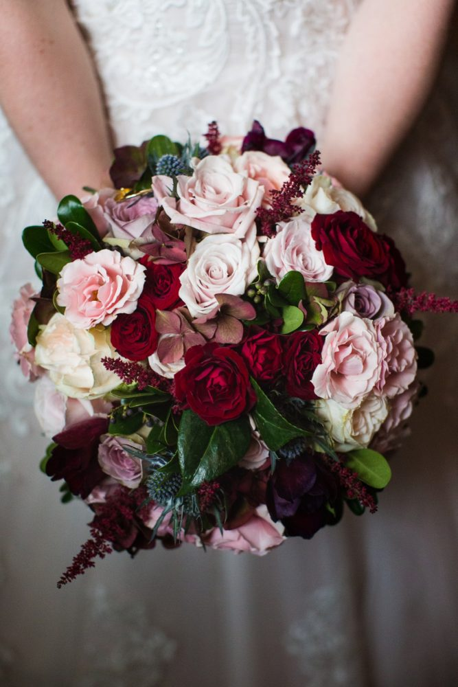Blush, Burgundy, Blue, and Green Bridal Bouquet with Roses, Thistle, and Greenery: Lush Blue & Burgundy Wedding at the Heinz History Center from Christina Montemurro Photography featured on Burgh Brides
