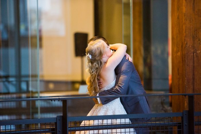 Bride Hugging Groom During First Look Session: Lush Blue & Burgundy Wedding at the Heinz History Center from Christina Montemurro Photography featured on Burgh Brides