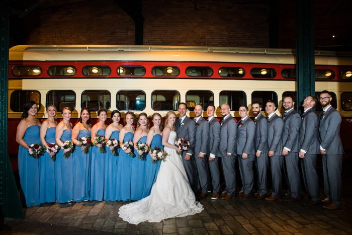 Bridesmaids in Long Dusty Blue Dresses and Groomsmen in Gray Suits: Lush Blue & Burgundy Wedding at the Heinz History Center from Christina Montemurro Photography featured on Burgh Brides