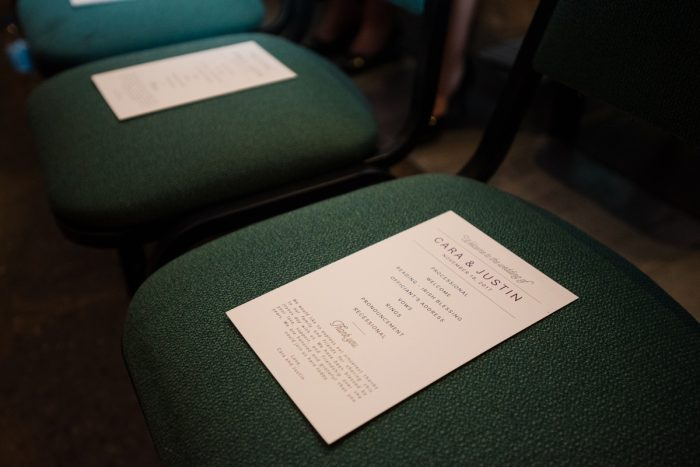 White Wedding Ceremony Programs on Chair: Lush Blue & Burgundy Wedding at the Heinz History Center from Christina Montemurro Photography featured on Burgh Brides
