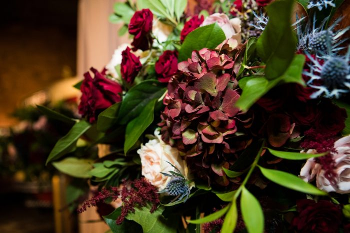 Blush, Burgundy, Blue, and Green Wedding Flowers: Lush Blue & Burgundy Wedding at the Heinz History Center from Christina Montemurro Photography featured on Burgh Brides