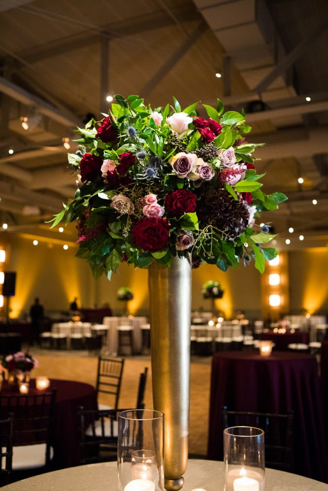Blush, Burgundy, Blue, and Green Wedding Flowers on Tall Gold Stand: Lush Blue & Burgundy Wedding at the Heinz History Center from Christina Montemurro Photography featured on Burgh Brides