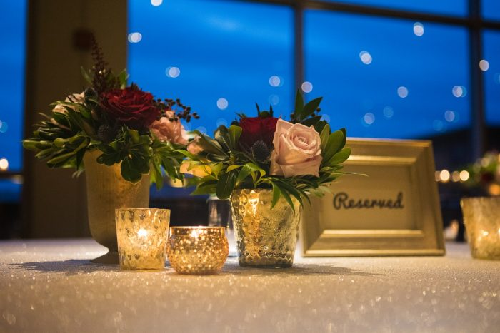 Blush, Burgundy, Blue, and Green Wedding Flowers in Gold Vases: Lush Blue & Burgundy Wedding at the Heinz History Center from Christina Montemurro Photography featured on Burgh Brides
