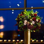 Blush, Burgundy, Blue, and Green Wedding Flowers in Tall Gold Stand: Lush Blue & Burgundy Wedding at the Heinz History Center from Christina Montemurro Photography featured on Burgh Brides
