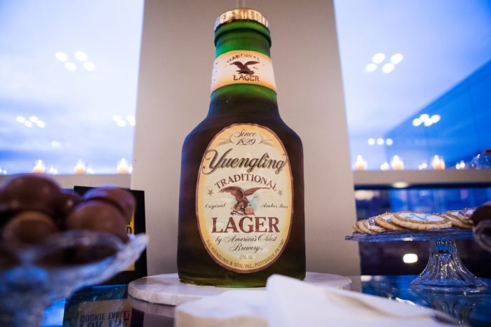 Yuengling Bottle Shaped Groom's Cake: Lush Blue & Burgundy Wedding at the Heinz History Center from Christina Montemurro Photography featured on Burgh Brides