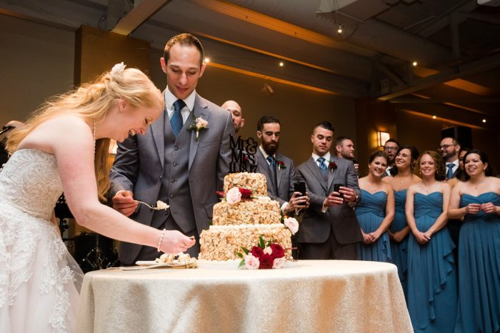 Bride and Groom Cutting Wedding Cake: Lush Blue & Burgundy Wedding at the Heinz History Center from Christina Montemurro Photography featured on Burgh Brides