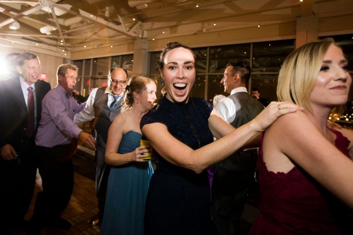 Guests Dancing at Wedding Reception: Lush Blue & Burgundy Wedding at the Heinz History Center from Christina Montemurro Photography featured on Burgh Brides