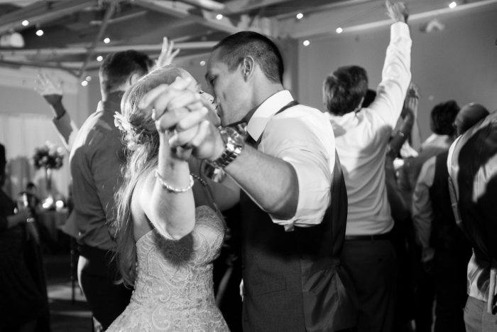Bride and Groom Dancing at Wedding Reception: Lush Blue & Burgundy Wedding at the Heinz History Center from Christina Montemurro Photography featured on Burgh Brides