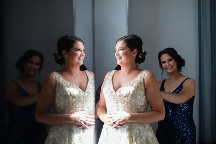 Bride in Gold Brocade Wedding Dress Getting Ready with Bridesmaids: Parisian Inspired Wedding at the LeMont from Kristen Wynn Photography featured on Burgh Brides