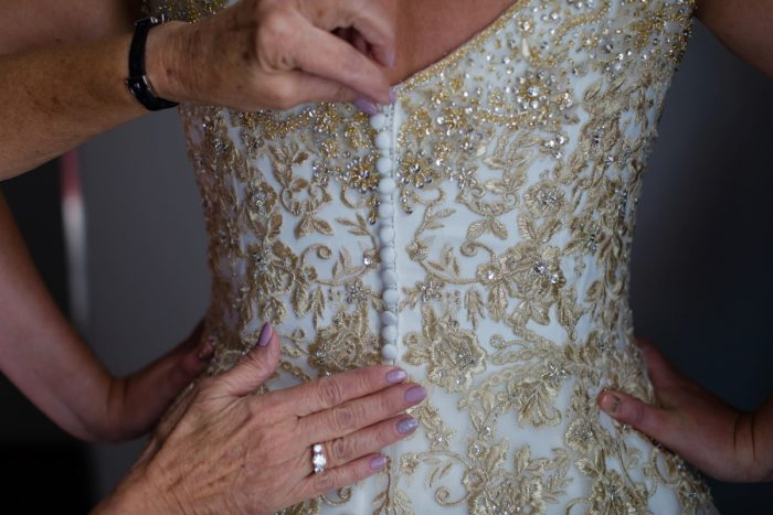 Button Back of Gold Brocade Wedding Dress: Parisian Inspired Wedding at the LeMont from Kristen Wynn Photography featured on Burgh Brides