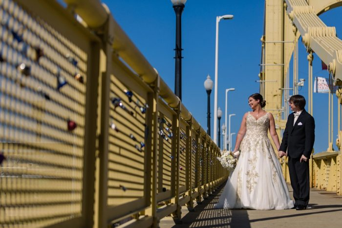 Bride and Groom on Pittsburgh Clemente Bridge: Parisian Inspired Wedding at the LeMont from Kristen Wynn Photography featured on Burgh Brides