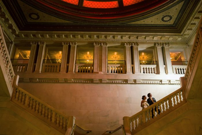 Bride and Groom on Staircase of Pittsburgh Renaissance Hotel: Parisian Inspired Wedding at the LeMont from Kristen Wynn Photography featured on Burgh Brides
