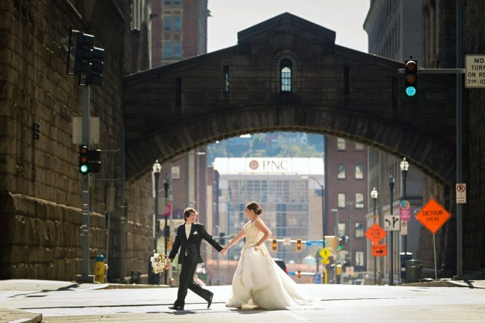 Bride and Groom Crossing Street in Downtown Pittsburgh: Parisian Inspired Wedding at the LeMont from Kristen Wynn Photography featured on Burgh Brides
