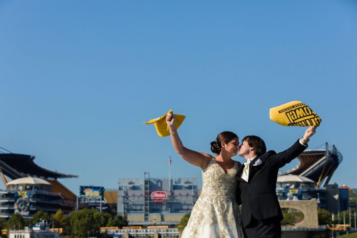 Bride and Groom Waving Terrible Towels Heinz Field: Parisian Inspired Wedding at the LeMont from Kristen Wynn Photography featured on Burgh Brides