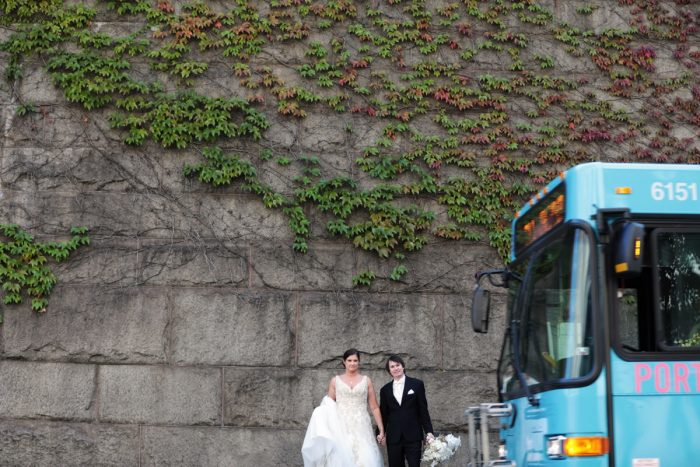 Bride and Groom Near Allegheny County Courthouse Ivy Covered Wall: Parisian Inspired Wedding at the LeMont from Kristen Wynn Photography featured on Burgh Brides