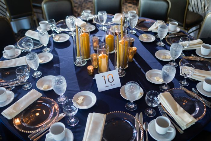 Blue Table Linen Gold Pillar Candle Centerpiece: Parisian Inspired Wedding at the LeMont from Kristen Wynn Photography featured on Burgh Brides