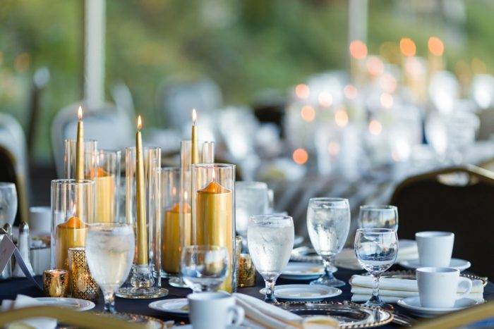 Gold Pillar Taper Candles in Glass Hurricanes Wedding Centerpieces: Parisian Inspired Wedding at the LeMont from Kristen Wynn Photography featured on Burgh Brides