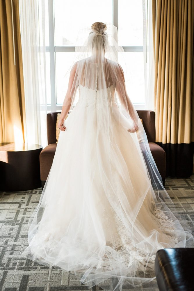 Bride with Top Knot in Wedding Dress: Warm & Romantic Winter Wedding at Duquesne from Loren DeMarco Photography featured on Burgh Brides