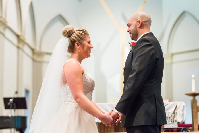 Bride and Groom Saying Wedding Vows: Warm & Romantic Winter Wedding at Duquesne from Loren DeMarco Photography featured on Burgh Brides