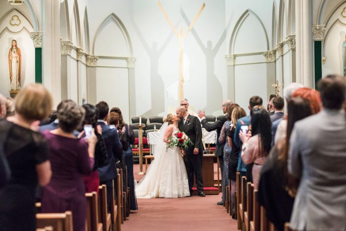 Bride and Groom First Kiss: Warm & Romantic Winter Wedding at Duquesne from Loren DeMarco Photography featured on Burgh Brides